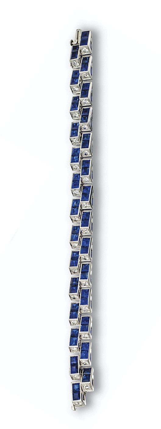 SAPPHIRE AND DIAMOND BRACELET, CIRCA 1940. The 'tank' style two-row bracelet set with 56 square-cut sapphires arranged in pairs, further decorated with 28 old European-cut diamonds, one set in each link, weighing a total of approximately 4.20 carats, mounted in platinum