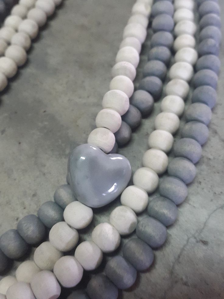 Necklace with natural and grey wooden beads
