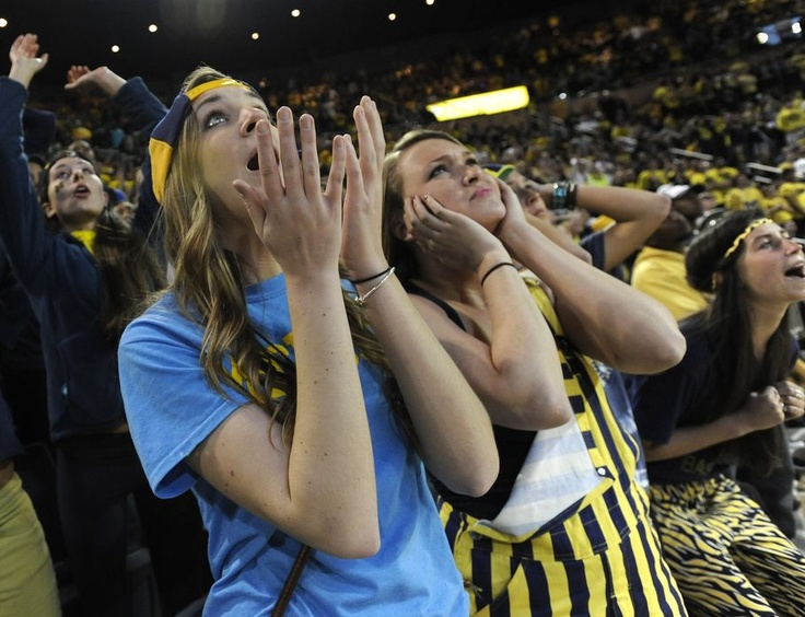 Associated Press Michigan Juniors Janna Kramer, left, and Anna Paneral watch the final moments of the game at Crisler Arena in Ann Arbor as Michigan falls to Louisville 82-76 in the NCAA final in Atlanta, Monday April 8, 2013. (AP Photo/The Detroit News, David Guralnick)