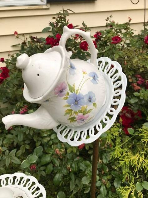 I call this one lacy bottom because the plates on the bottom look like lace beneath the vintage china. fill the cup with birdseed to bring birds to your yard or leave as is for beautiful yard/garden artwork .... galvanized and copper fittings screw into the back of the tea pot