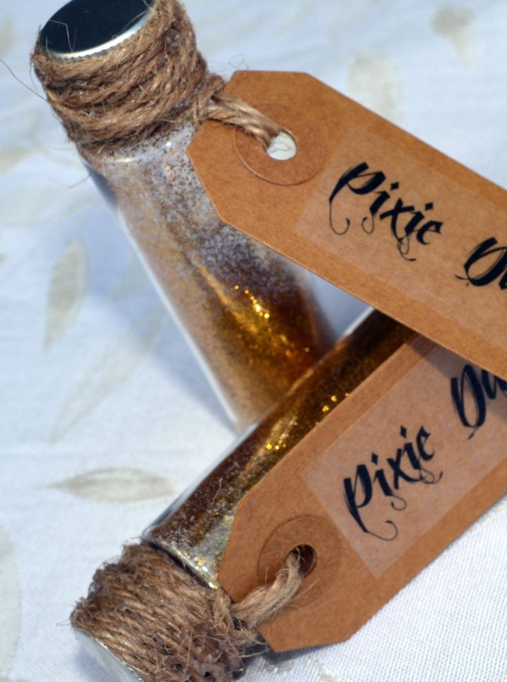 neverland party- favours- glitter in mini glass& cork top bottles labelled.