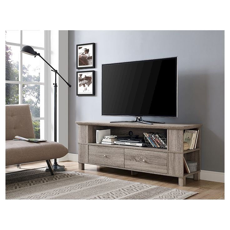 """Display your TV in style with this 60"""" wood media console. Built to support TVs up to 65 inches crafted from high-grade MDF with a durable laminate finish to fit your home décor Features side shelving perfect for storing DVDs, CDs, and games. Its cable management system and storage drawers help you maintain a tidy entertaining space."""