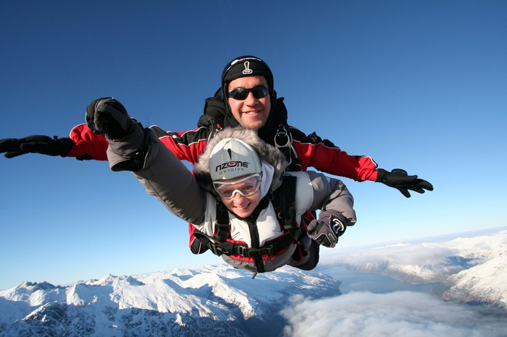 Skydiving over the snowy mountains of Queenstown