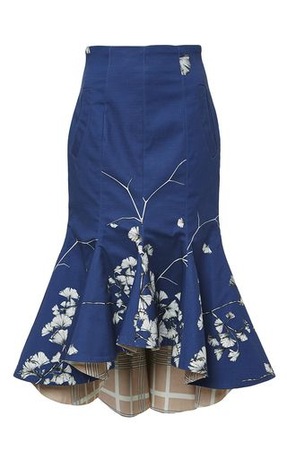 This ginkgo tree patterned **Johanna Ortiz** skirt features a high rise, side pockets and a trumpet silhouette with a contrasting plaid lining.