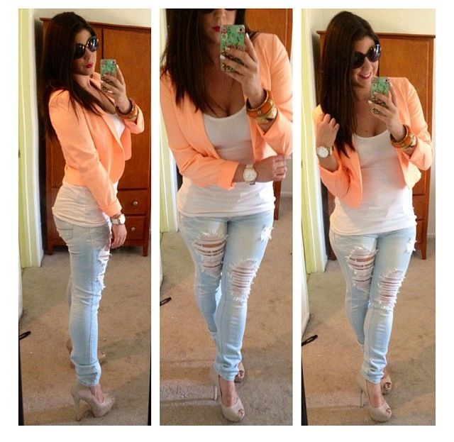 Faded, ripped skinny jeans with a cropped orange cardigan over a white tank.