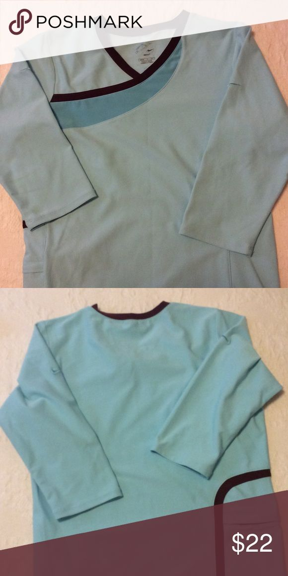 Nike cycling top Light turquoise w/brown trim. Pocket on back. Nike Tops