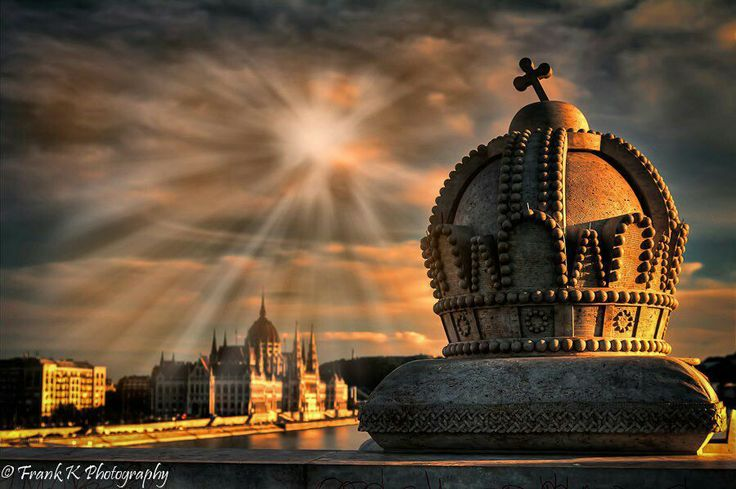 Budapest, Hungary. Sun shining on the Parliament and one of the decorative crowns on Margaret Bridge.