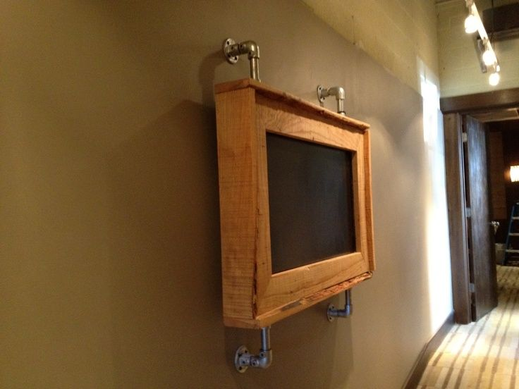 custom tv frame for industrial office space can be used anywhere this is a display with steel piping and wormy ash wood super slick