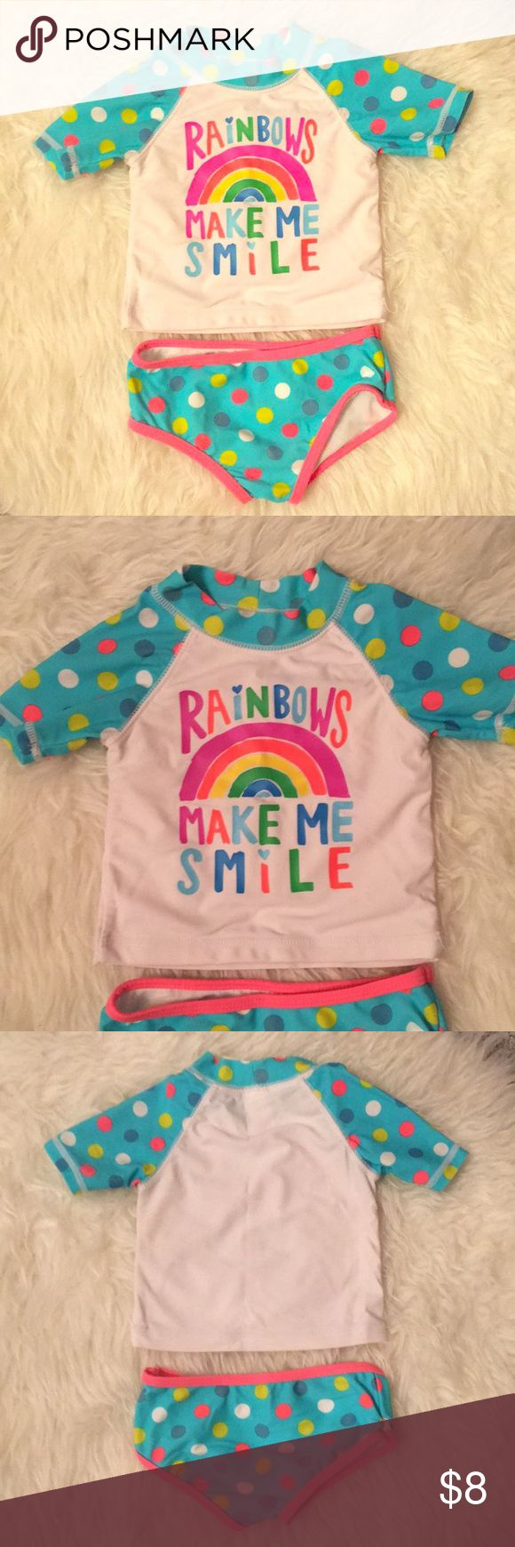 Carter's Rainbows 🌈 Make Me Smile Swimsuit Adorable Carter's Rainbows 🌈 Make me smile Swimsuit. Two pieces. Short sleeve rash guard top is perfect for shielding your little love from the sun! Great used condition. Only a little wear in the crotch area (shown in picture). Not noticeable at all once on.  🚫 from a pet and smoke free home ❌ no tears or stains  📬 next day shipping (unless next day is Sunday or holiday) Carter's Swim Rashguards