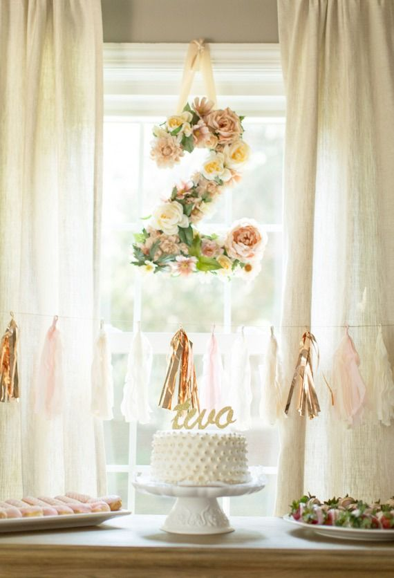 Can you believe your baby is turning two? This rose-decorated birthday party is a lovely look for celebrating your wee one! With a floral 2 and shimmery metallic streamers, your party will be a memorable event!