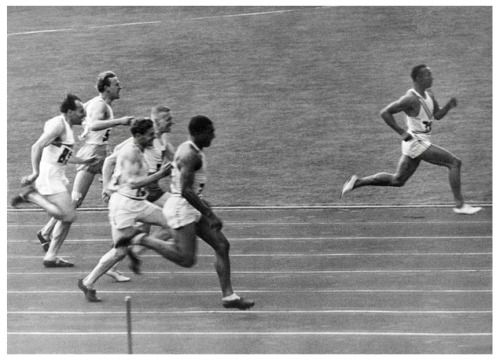 August 3, 1936. American track and field athlete, Jesse Owens, wins the 100 meter dash at the 1936 Summer Olympics in Berlin, Germany.