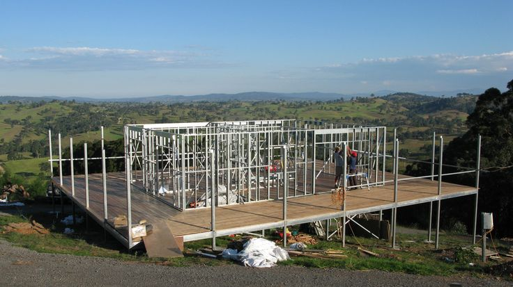 Posts through to roof installed and wall frame in place on this steel frame house.