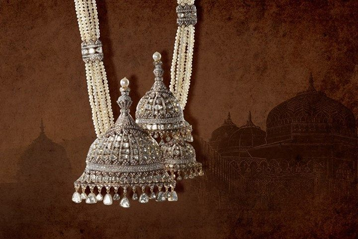 The treasured heritage of Rajasthan is magnificently cherished in this pendant necklace which is designed in the shape of glorious Chattris of the Amer Fort!
