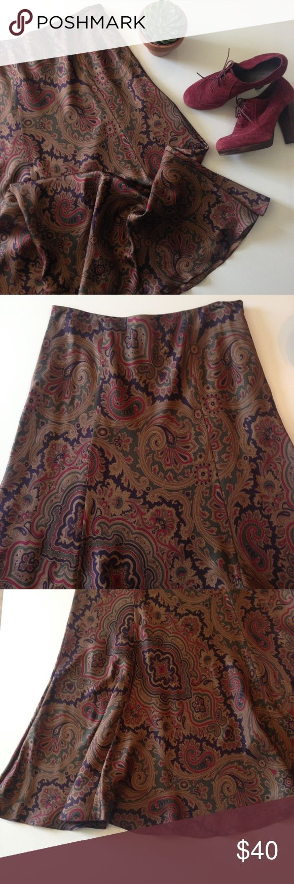 LAUREN Ralph Lauren silk skirt This gorgeous silk skirt is fitted through waist and hips, flaring out at the bottom, trumpet style. Beautiful fall colors, paisley print. This is a classic piece that you'll have forever! It has a side zip closure and is fully lined. In EUC - like new, no flaws. I love this with a chunky turtleneck sweater and riding boots or heeled oxfords. Lauren Ralph Lauren Skirts Maxi