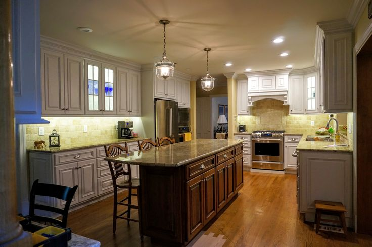 Custom Kitchen White Painted Cabinetry with Medium Stained Island, Stainless Appliances, Cup Hold Drawer Pulls, Custom Countertops
