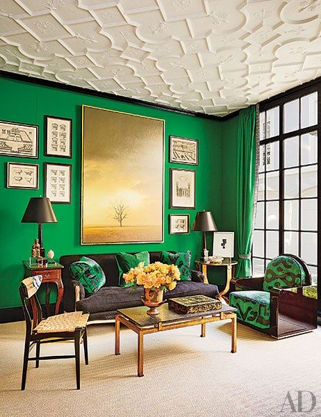 In a Houston family room designed by Miles Redd, a Holland & Sherry wool felt the color of malachite serves as the background for a Louis XV–style sofa upholstered in a Larsen linen and an Art Deco club chair cushioned with the same Turkish velvet used for the throw pillows; the sisal is by Patterson Flynn Martin.