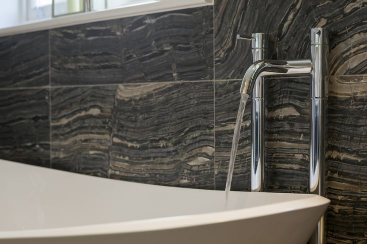 Blue Lagoon porcelain tiles adding interest to a classical bathroom - Stone & Ceramic Warehouse. #bathroom #interiors #interiordesign #interiorinspiration #bathroomremodel #tiles #tiling #splashback