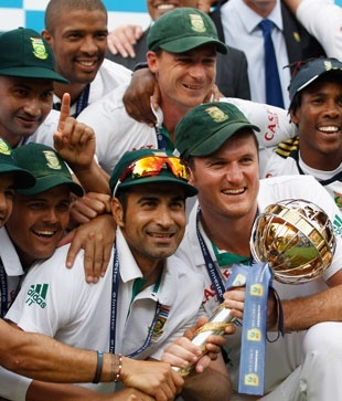 Graeme Smith leads South Africas celebrations with the Test Championship mace after victory at Lords click photo