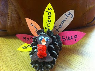 Thanksgiving pinecone turkeys...we made these with lunch bags stuffed w/ shredded paper....kids had so much fun...interesting to see what they're thankful for!