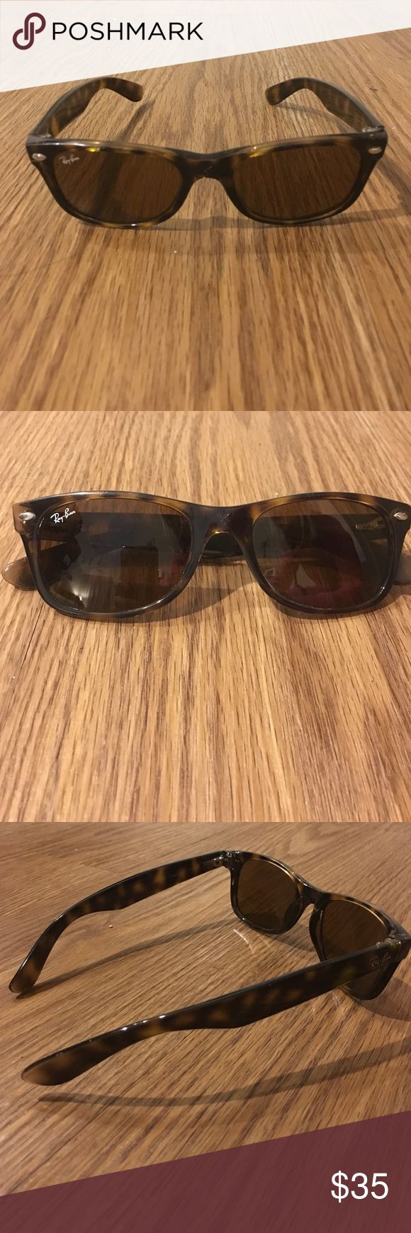 Ray Ban Wayfarers Ray ban wayfarers. Scratched between the lenses but in pretty good condition. Have been worn a lot. Smaller size. Tortoise color. Ray-Ban Accessories Sunglasses