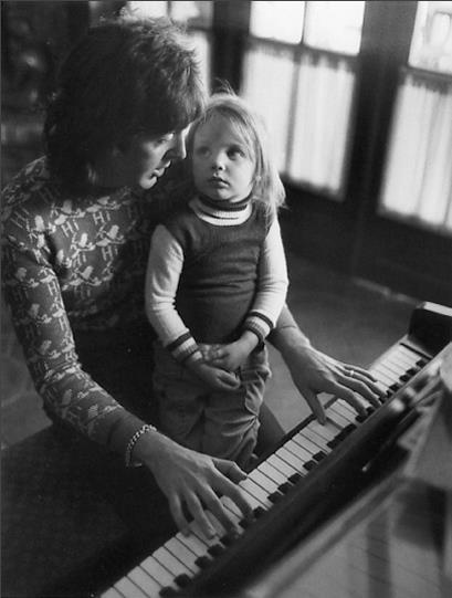 Stella McCartney on daddy's lap, in 1975