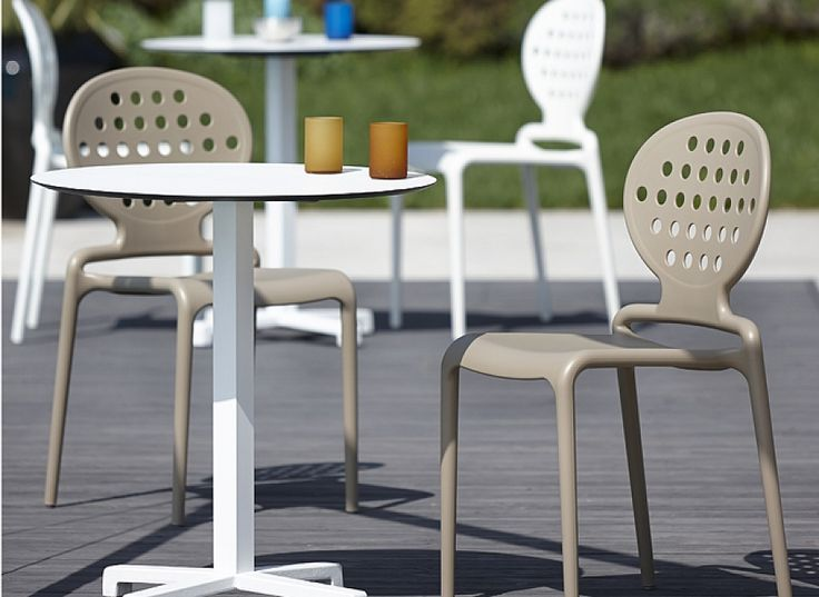 Contemporary stacking indoor/outdoor chair Holes by Scab