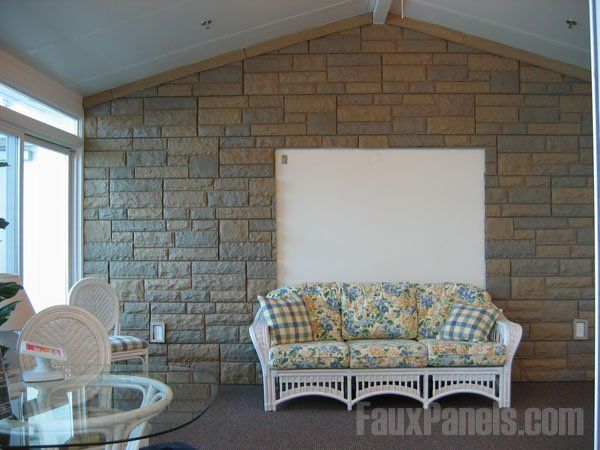 Faux rock panels are an interesting contrast in a bright sun room