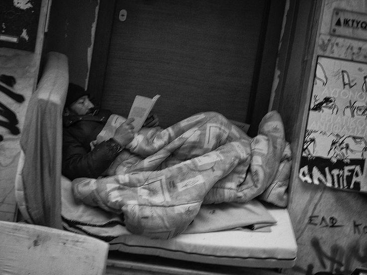Homeless, reading; Athens, Exarchia
