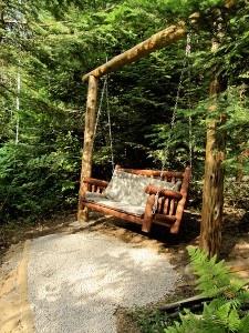 Log swing over looking seasonal stream.