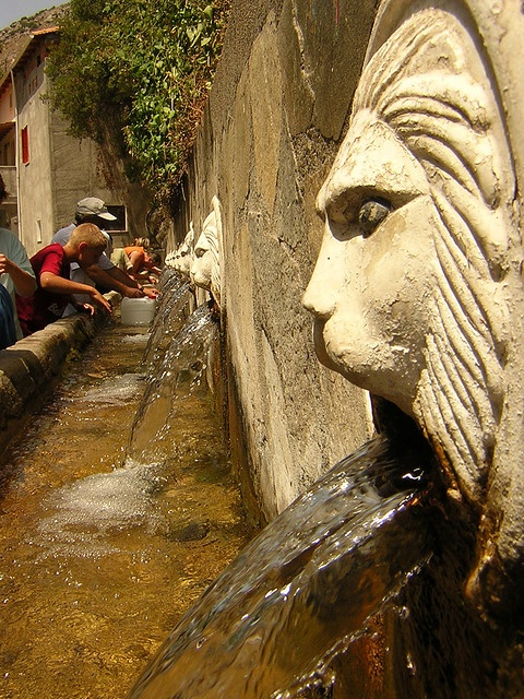 Here's even more WOW factor. In Italy's big cities, particularly Rome, aqueducts still feed the water system. Alot of the water that feeds the fountains is crystal clear from the mountains. At fountains such as the one you see above, the water is totally drinkable!