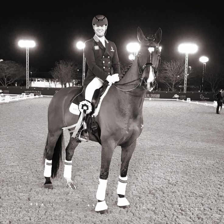 Spencer Wilton and Super Nova II, a Bay British Hanovarian gelding, after winning the Grand Prix Special in Doha