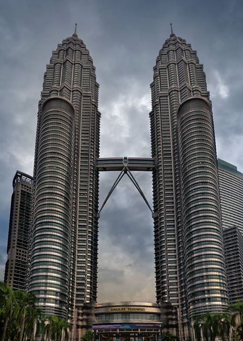 The ‪Petronas Towers in ‎Kuala Lumpur‬, ‎Malaysia, is the world's ‪‎tallest twin-‎building, standing at a height of 1483 feet.
