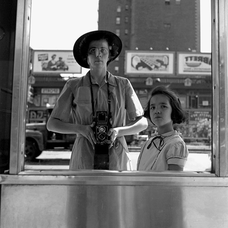 (trefusis stories board 1 of 3: young and with company) Vivian Maier - mirror self portraits. Cute with the girl!