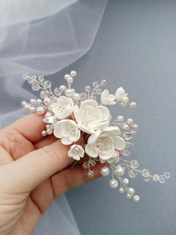 This beautiful handmade bridal hair comb made with pretty crystal elements, handcrafted flowers and white glass pearls. Complement most wedding hairstyles. It is the perfect bridal headpiece for that woman who wants to simply sparkle on her wedding day. DIMENSIONS: 6.5 x 2.5 (16 x 7 cm) (Please note, this does not include the comb itself).  Silver, gold or rose gold tone finish.  White or Ivory crystal pearls.  View my shop for more handmade bridal headpieces: https://www.etsy.com&...