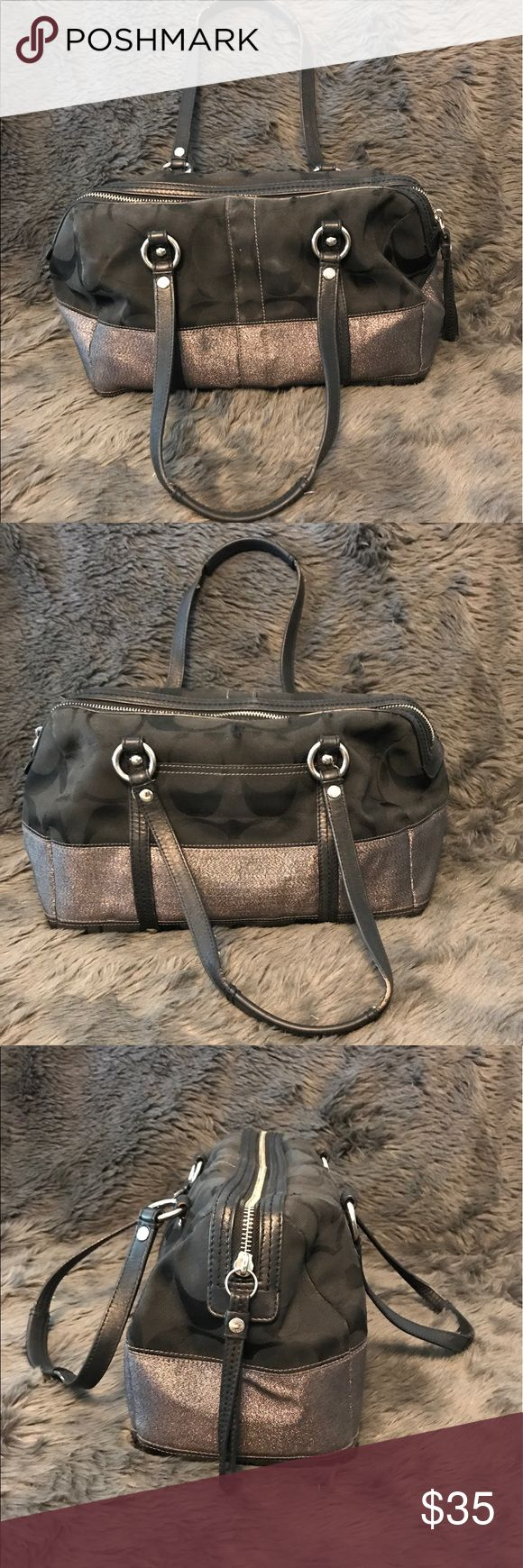 "Coach Satchel Timeless Coach Satchel, Black Logo Nylon with Silver Metallic Leather Stripe and Silver Tone Accents. Pre-loved with some peeling on handle, not noticeable when being carried.  Approximate size 13""L x 5.5""W x 8""H with a 9"" strap drop. Coach Bags Satchels"