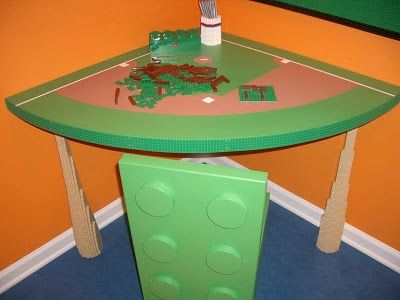 Cute lego corner table.  That big green lego is a chair.