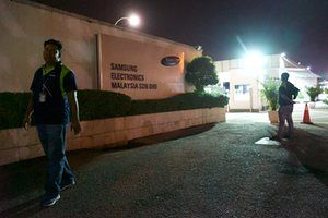 Workers (not interviewed by the Guardian) at the entrance to the Samsung plant in Port Klang.