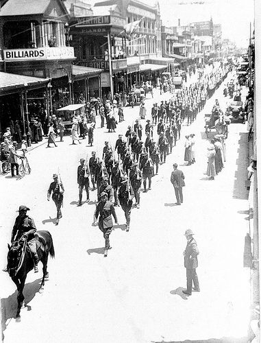 PRG 280/1/9/152. A military procession in Rundle Street moving east, with part of the procession behind moving down Hindley Street towards the King William Street corner, Adelaide, South Australia, WWI.