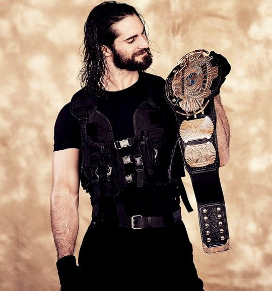 Seth Rollins holding the old WWF Title