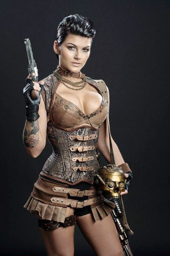 What we have here is the ultimate in steampunk fashion; a brown satin-style corset beautifully decorated with a gold-colored vintage design covering the majority of the garment. Description from pinterest.com. I searched for this on bing.com/images