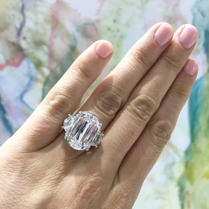 Remember that time we traveled to #JCKLasVegas and tried on this million dollar ring from @CrissCutDiamond? 💍 We do! How could we ever forget?! #BestDayEver ✨ Click the link in bio to see more #TheKnotRings like this one! #ad