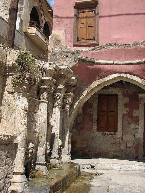 Windows overlooking an old fountain, Rethymno, Crete, Greece