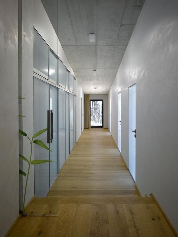 Exposed concrete ceiling minimalist interior corridor