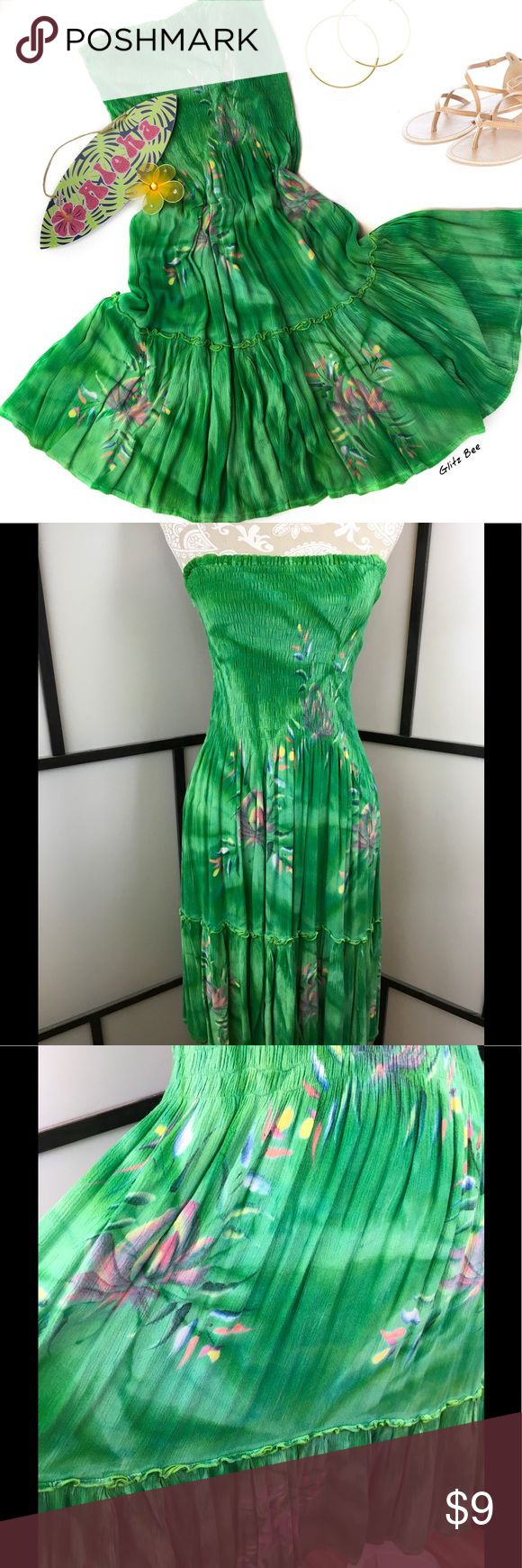 Green Floral Batik Strapless Dress, L/XL Bright green strapless batik sundress with a full skirt and elastic top. Size large to extra large, no flaws to note. Bust-14-21 elastic, Length-34.  Fun, carefree dress for a summer festival or top over your swimsuit for lunch by the pool. Tropical Batik Dresses Midi