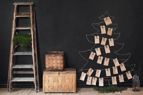 blackboard with christmas tree drawn, woven baskets and an old ladder.