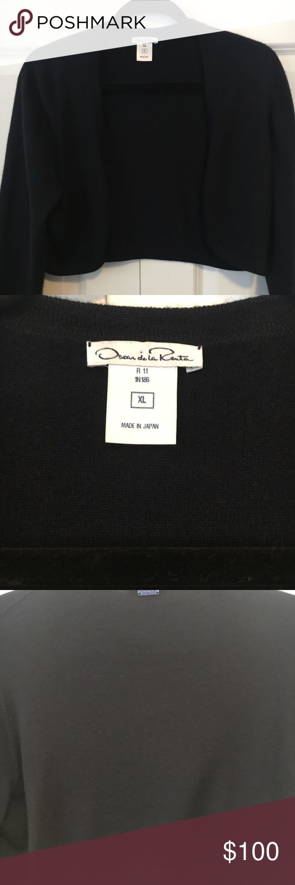 """🔥 Oscar de la Renta Navy Shrug Beautiful cashmere shrug by Oscar De La Renta.  In fabulous condition, no issues.  Never worn out.    Navy blue color.  Perfect over dresses for prom or wedding season.  Looks beautiful with printed tanks or blouses.  Open front.   16"""" long, 18"""" sleeve Oscar de la Renta Sweaters Shrugs & Ponchos"""