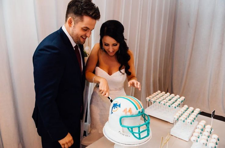 Miami Dolphins cake pops, Miami Dolphins wedding cake, football helmet cake, football fan, football Sunday, Wedding cake pops, unique wedding cake idea, wedding cake idea, party idea, gimme some sugar, grooms cake