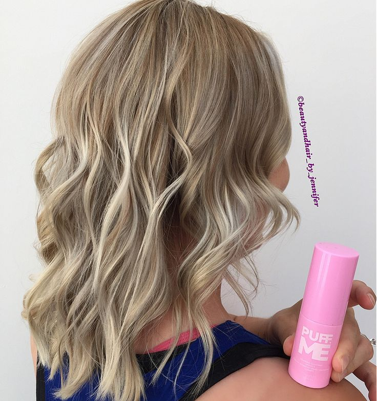 Pastel blonde with a root shade.