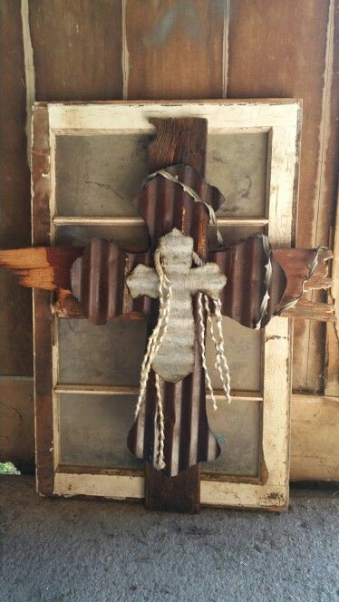Old Barnwood Cross's cut from tin old barbed wire and rope.