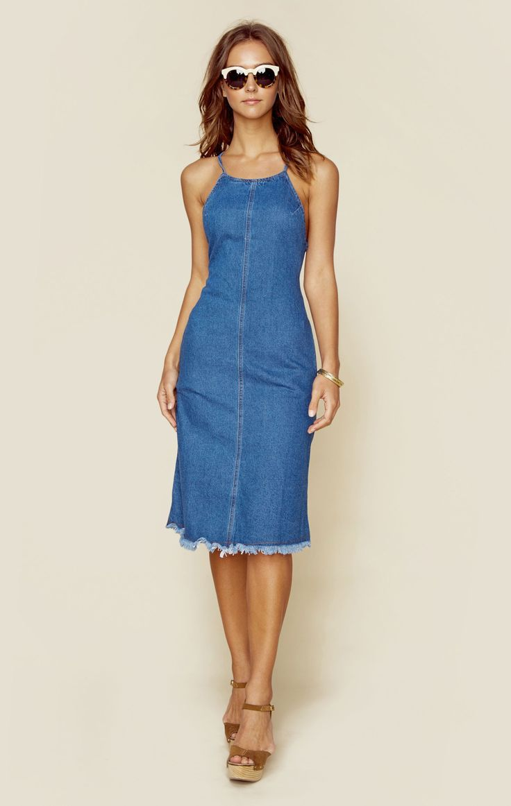 """This retro denim dress is Astr The Label's Yolanda Dress. Featuring criss cross straps in the back, high neck, exposed back zipper, and midi length. ImportedHand Wash Cold100% CottonFit Guide:Model is 5ft 9 inches; Bust: 33"""", Waist: 23"""", Hips: 33""""Model is wearing a size XSRelaxed FitShoes Featured Not Available For Purchase"""